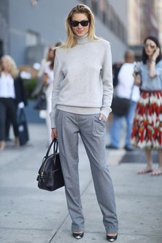 NYFW Street Style Day 7: Jessica Hart gave us a taste of Fall in her gray sweater and trousers.