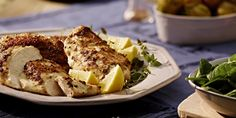 Warm up your dinner guests with this delectable chicken marinated in Black Olive and White Wine mustard and served over a light salad.