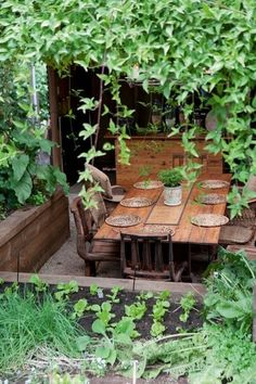 sunken dining area of interest and possible with our property's grading.  of note, overhead vines and raised herb planter or terracing.