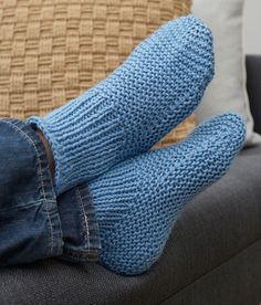 Free Knitting Pattern for Easy Time-Off Slippers - These easy cuffed slipper socks are knit flat and seamed. 4 sizes – Men's 10, 11, 12, 14. Rated easy by Red Heart. Designed by Christine Marie Chen