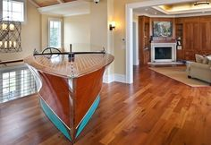 This Boat Bar is really cool, but you'd really have to have a LOT of room to make this work.  Not to mention, HOW did they get it IN the room?  ha ha ha!