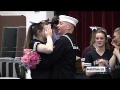 FC1 U.S Navy Service Member William Smith gave his daughter the surprise of a lifetime during her cheer practice. His daughter, 17, didn't see it coming while she practiced with her team for their big competition the next day. She assumed they were doing an extra performance for parents, but didn't know she'd have her own dad in the audience. As soon as he walks out she falls the floor, her face cupped in her hands, crying out of pure joy.