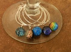 wine glass charmsdichroic fused glass by MarchelDesigns on Etsy