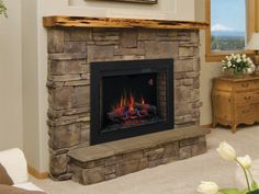 33II310GRA Classic Flame electric fireplace with BBKIT33 trim/surround kit installed in a stone fireplace