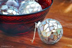 These mosaic upcycled ornaments are made from old CDs. This is an easy Christmas DIY. Get ahold of some glass ornaments and dust off those CDs.