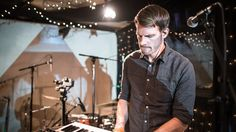 """San Francisco electronic musician Tycho (a.k.a. Scott Hansen) continues to flesh out and perfect a beautiful, captivating sound-world. Watch him perform """"L"""" with the help of a three-piece band."""