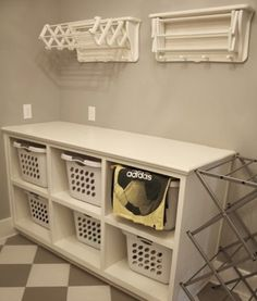 Laundry room storage ideas with baskets and drying rack