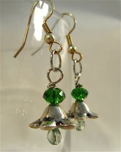 Green and silver glass flower bead earrings. $18.00, via Etsy.