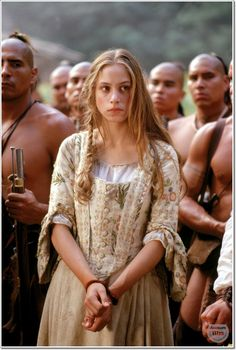 Jodhi May in The Last of the Mohicans. This may sound like it's too picky to believe, but this shot captures everything anachronistic in our movies about native people: most of all, the musculature. Men then and there were taught though normal; big pecs and biceps are all developed in gyms nowadays, and read as middle-class modern exercise, but not as natural men.