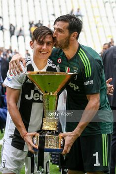 Juventus forward Paulo Dybala and Juventus goalkeeper Gianluigi Buffon celebrate holding the Serie A soccer title trophy after the Serie A football match JUVENTUS - VERONA on at the Allianz Stadium in Turin, Italy. Football Gif, Football Boys, Football Match, Football Players, Juventus Goalkeeper, 1 J, Verona, Soccer, Turin Italy