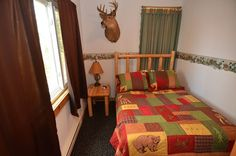 One of 2 bedrooms - http://clamlakewi.com/bearcabinrentallowerclamlakewi.htm