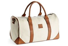 bac65c1214 This classic duffel bag is constructed of durable canvas and finished with  leather trim.
