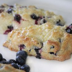 Easy recipe for blueberry scones with lemon glaze. Sweet and tangy, they're the best!