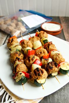 Marinated chunks of sweet red pepper, bold yellow onion and zucchini join garbanzo and pinto bean balls in these Grilled Greek Kebabs, destined for the grill! AND they are freezer friendly!