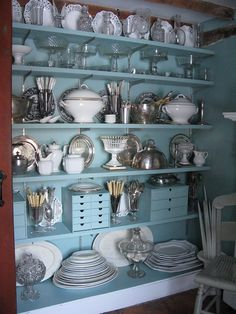 """From bookshelves to butler's pantry. Perfect solution for husbands's comment of """"You need to merchandise your lamps."""" Until I get a real butlers pantry this a an awesome basement use for table pieces."""