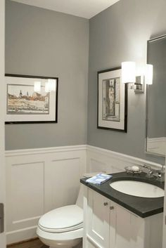 Pikes peak grey with blue undertone from Benjamin Moore looks great with the white wainscoting . Love this