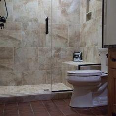 Tiled Shower: Vesale Stone 20x20, Sand; Grout: Mapei, Biscuit; Shower Floor: Vesale Stone 2x2 Mosaic, Sand; Bathroom Floor: Old Castillo Terracotta 6-1/2x6-1/2, Dark Brown; Flooring Grout: Tec Power, Summer Wheat