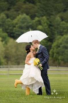 Awesome Yellow boots and flower accent to this Riverside Farm, Vermont Wedding Photo - by Wayne & Angela - umbrella wedding photography