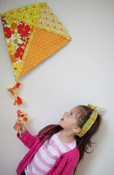 DIY - wooden dowel frame, purple/green/white/yellow fabrics, 3-5 kite cluster to hang from Em's ceiling.