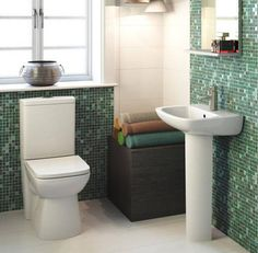 Renoir compact flush to wall toilet with 450mm basin and pedestal.