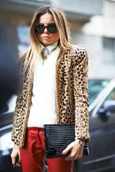 Leopard print gets tough with gold chain details and a studded clutch #streetstyle