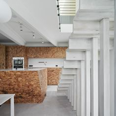 fitted furniture made of oriented strand board (OSB) in  Fitzroy, Melbourne by  Edwards Moore Architects