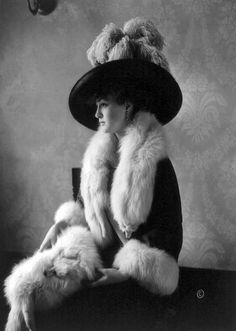 Louise Cromwell Brooks (1890-1965) was an American socialite considered to be one of Washington's most beautiful young women.  She is shown here in 1911 at the age of 21 wearing a most fashionable ensemble. She was married to General Douglas MacArthur from 1922-1929.