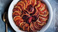 This layered dish of seasonal beets, tomatoes and potatoes has a deep color that brings the tint of fall leaves right to your Thanksgiving table.