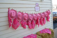 Pink hats and bandannas at a cowgirl birthday party! See more party planning ideas at CatchMyParty.com!
