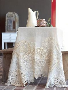 Re-purpose old doilies, sew them onto a linen table cloth