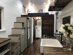 From Sun Bear Tiny Homes is the White House, a tiny house featuring beautiful Brazilian Pecan hardwood floors and butcher block countertops. Best Tiny House, Tiny House Cabin, Tiny House Plans, Tiny House On Wheels, Tiny House Design, Tiny Houses For Sale, Little Houses, Tiny House Bedroom, Tiny House Trailer
