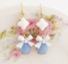 Vintage Periwinkle Blue Jewel with White Enamel Bow and White Square Glass Jewel Dangle Earrings. $24.00, via Etsy.