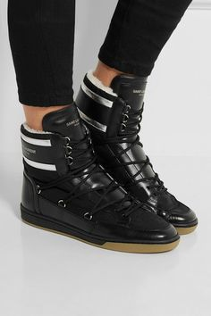 Sole measures approximately 25mm/ 1 inch Black and silver leather, black shell, cream faux shearling Lace-up front