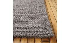 Thatch rug would be a good choice because it is 100% wool and would withstand rough use by a child