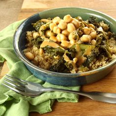 Tender galicky kale and chickpeas are served over quinoa and topped with tangy tahini sriracha dressing to make this simple but flavorful vegan meal.