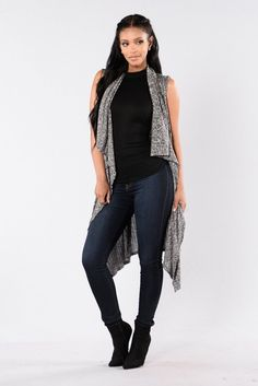 - Available in Grey - Long Sweater Duster - Sleeveless - Open Front - Wrap Waist Tie - Ribbed - Made in USA - 58% Rayon 38% Polyester 4% Spandex