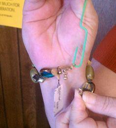 Use a paper clip to put on those tiny bracelets