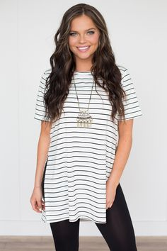 Shop our Splitting Sides Striped Tunic. Black and white striped. Pair with leggings. Rayon. Always free shipping on US orders $50 & up!