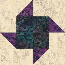 Paper Pinwheels, an easy quilt block pattern with lots of spin. The patchwork quilt block resembles whirling pinwheels sold at fairs and other festivals.