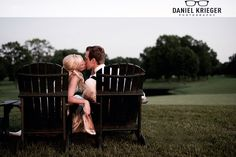 bride and groom in lawn chairs.. lakeside wedding