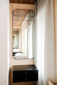 A tiny 22 sqm Art Deco studio apartment in inner city Sydney has been transformed into a stylis...