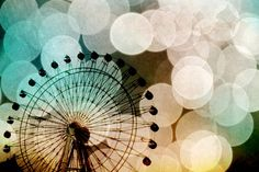 I love this interesting photo of a ferris wheel from SylviaCPhotography at Etsy.  8x12 Endura Metallic Photo Print for $29