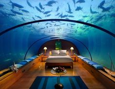 We've all woken up from deep sleep feeling a bit blue. But at the Conrad Maldives Rangali Island some guests now have the chance to awake under the deep blue with schools of fish swimming by and rays of sunlight shimmering through the water to the new Ithaa Suite. The room sits 16 feet below the Indian Ocean, surrounded by a vibrant coral reef and encased in clear glass