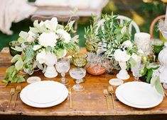 gold flatware, cut crystal, champs coupe, white plates -- exact replica of how the table will be set minus the green goblet