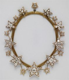 The necklace is entitled Necklace of the Stars (Colar das Estrelas) and was commissioned in 1865 for the wife of King Luis I of Portugal, Queen Consort Maria Pia of Savoy, who had a love for jewelry and fashion. The necklace and matching diadem was also fashioned in the workshop of the Portuguese Royal Jeweler Estevão de Sousa in Lisbon, Portugal. Gold, silver, diamonds, pink diamonds. 3.9 x 42.5 cm http://www.agelessheirlooms.com/royal-jewels-portugal/