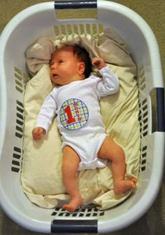 monthly pictures of baby idea - Google Search   LOL, I thought we were the only people who bedded down an infant in a laundry basket!!!