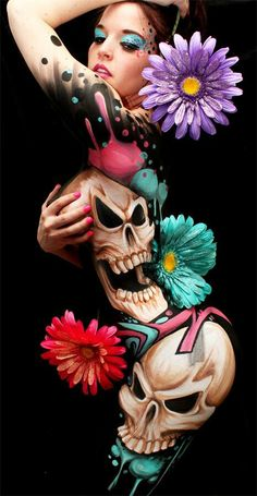 This is body paint but the top of the hip/thigh is an awesome place for my skull tattoo idea I have!
