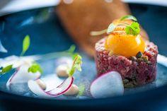 Our very popular starter - Steak tartare, confit egg yolk, pickled radishes, crispy sourdough #lortolan #finedining #food #michelinstar