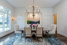 2117 Maconda Ln Houston, TX 77027: Photo Dining room with custom blended wide plank multi-species hardwood floors, 12 foot ceiling, recessed lighting, art lighting, , triple-crown molding, recessed niche for buffet, built-ins, wired for sound
