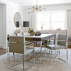Wood and Chrome Dining Table with Gray Dining Chairs